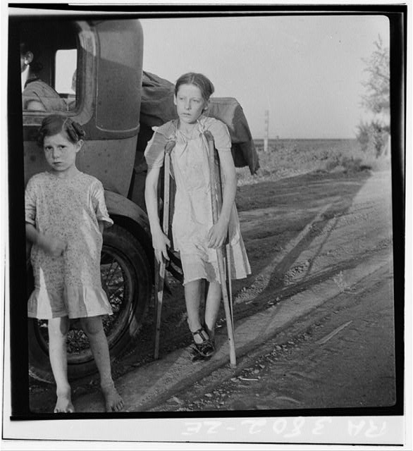 Children of Oklahoma drought refugees on highway near Bakersfield, California. Family of six; no shelter, no food, no money and almost no gasoline. The child has bone tuberculosis