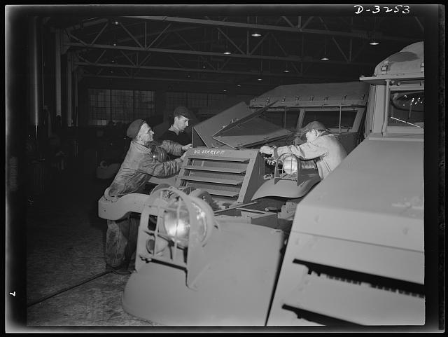 Careful plant inspections assure that each new Army scout car is correct in every detail before it leaves the production line of a large Midwest truck plant. White Motor Company, Cleveland, Ohio