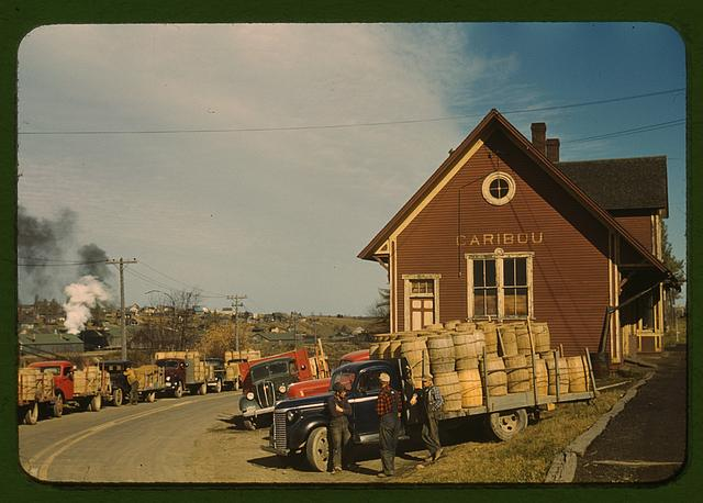 Trucks outside of a starch factory, Caribou, Aroostook County, Me. There were almost fifty trucks in the line. Some had been waiting for twenty-four hours for the potatoes to be graded and weighed