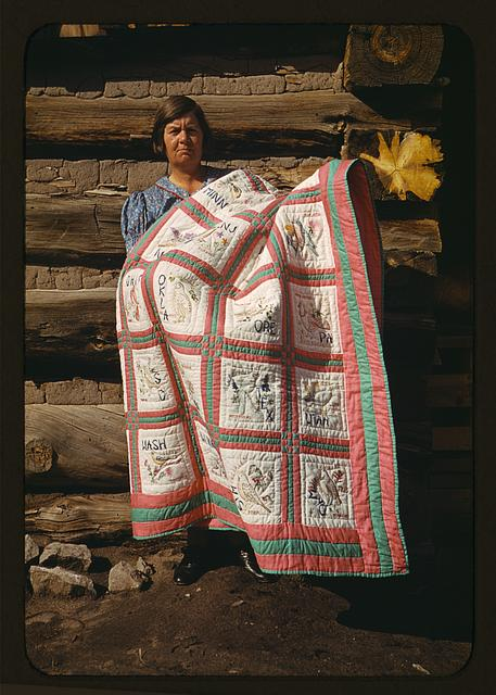 Mrs. Bill Stagg with state quilt, Pie Town, New Mexico