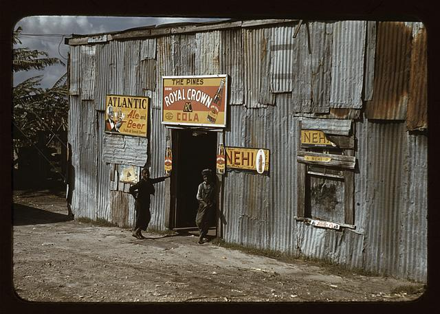 "Negro migratory workers by a ""juke joint"" (?), Belle Glade, Fla."