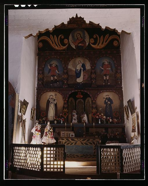 The main altar in the church, Trampas, N.M. There are paintings on the wall behind the altar