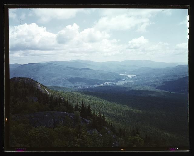 [A view looking northeast from the fire tower manned by Barbara Mortensen, a fire and airplane lookout on Pine Mountain, Gorham vicinity, N.H.]