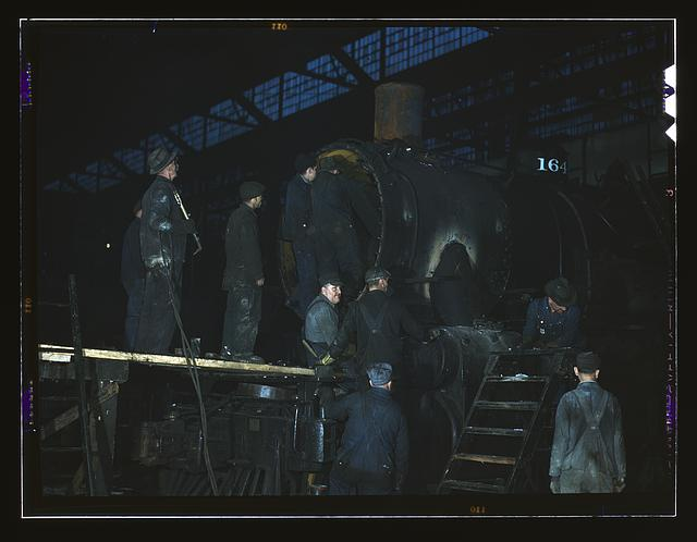 Working on a locomotive at the 40th Street shop of the C & NW RR [i.e. Chicago and North Western railroad], Chicago, Ill.