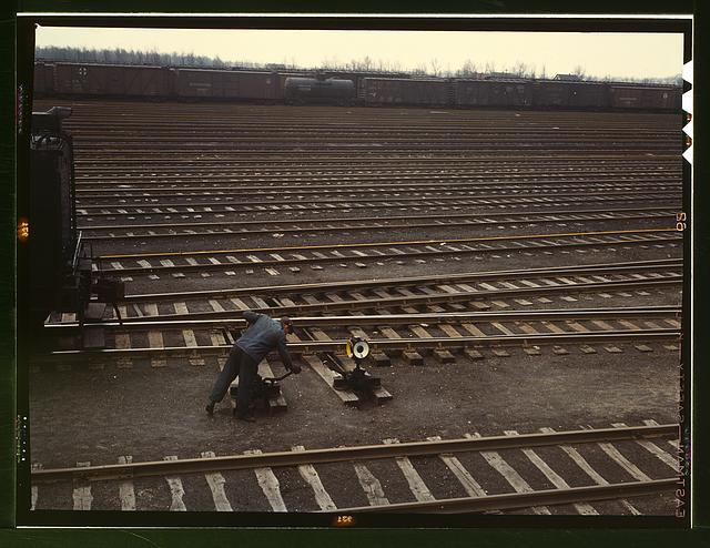 Switchman throwing a switch at C & NW RR's [i.e. Chicago and North Western railroad's] Proviso yard, Chicago, Ill.