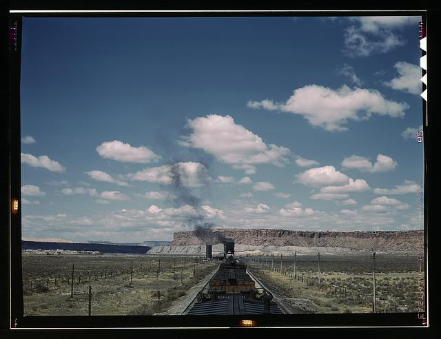 A freight train stopping for coal and water at a siding enroute to Gallup, New Mexico, near Laguna, N.M.