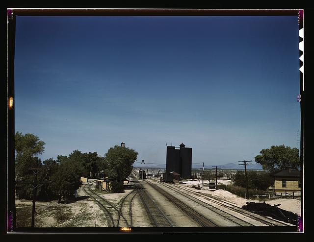 Santa Fe R.R. going through Yucca, Arizona; a watering and refueling stop