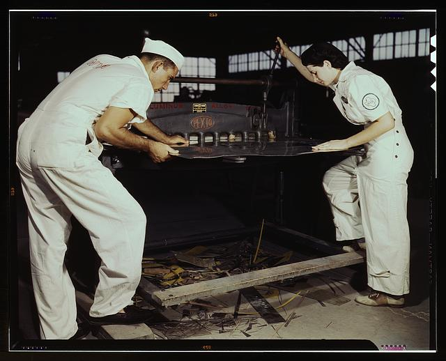 Learning to work a cutting machine, these two NYA employees receive training to fit them for important work, Corpus Christi, Texas. After eight weeks they will be eligible for civil service jobs at the Naval Air Base