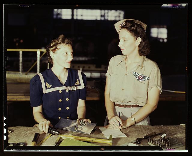 Pearl Harbor widows have gone into war work to carry on the fight with a personal vengeance, Corpus Christi, Texas. Mrs. Virginia Young (right) whose husband was one of the first casualties of World War II, is a supervisor in the Assembly and Repairs Department of the Naval Air Base. Her job is to find convenient and comfortable living quarters for women workers from out of the state, like Ethel Mann, who operates an electric drill