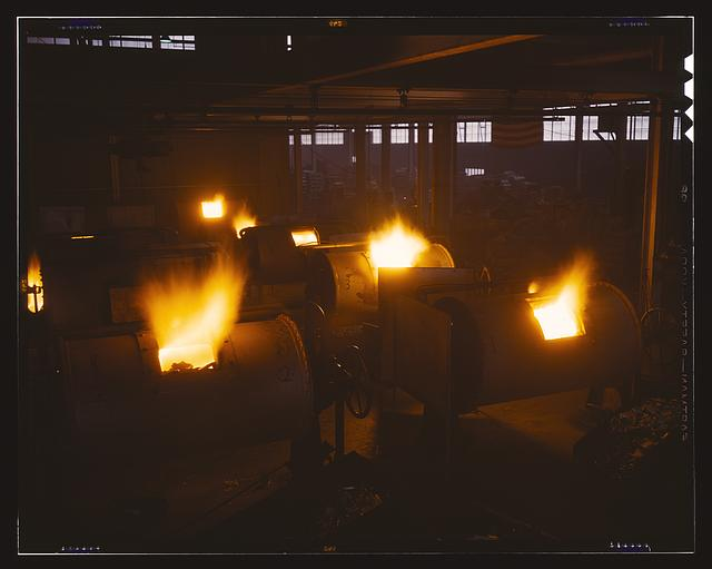 A battery of 1,000 and 2,000 pound furnaces roaring threats to the Axis. These are rotary, oil-fired melting furnaces at Aluminum Industries Inc. Destination of the finished aluminum products is kept secret