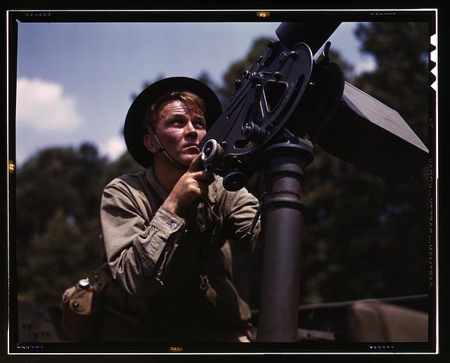 Good man, good gun: a private of the armored forces does some practice shooting with a 30-calibre Browning machine gun, Fort Knox, Ky. The gun is mounted on a pedestal for anti-aircraft work