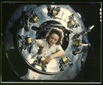 Woman working on part of the cowling for one of the motors for a B-25 bomber
