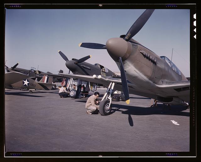 "P-51 (""Mustang"") fighter planes being prepared for test flight at the field of the North American Aviation, Inc., plant in Inglewood, Calif."