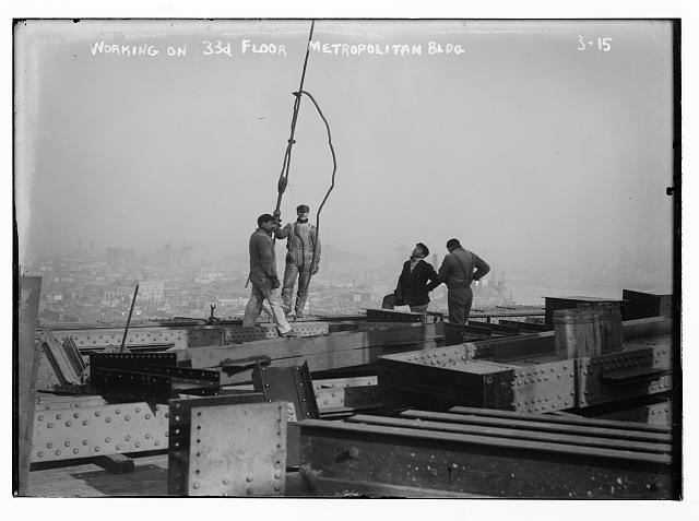 Men working on 33rd fllor Met. Bldg. , New York