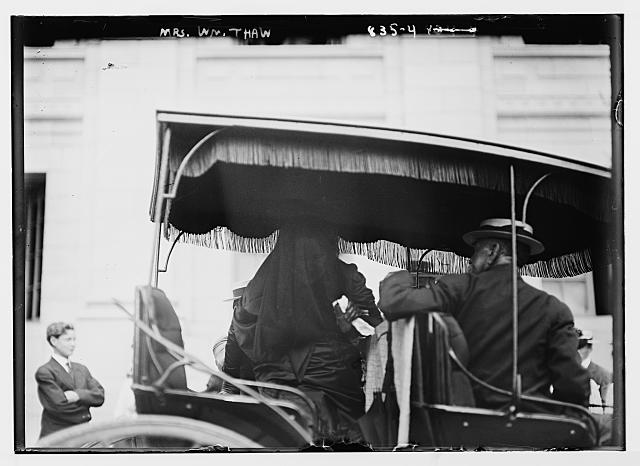 Mrs. Wm. Thaw, veiled, in carriage with gentleman, New York