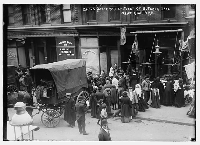 Crowd gathered in front of butcher shop during meat riot, New York