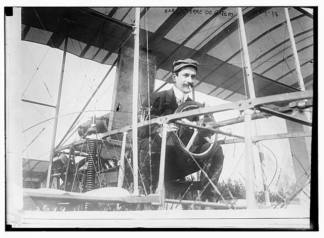 Baron Pierre de Gaters at wheel of aeroplane