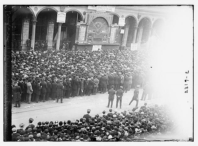 "Crowd watching ""playograph"" at Herald Building, World Series, 1911"