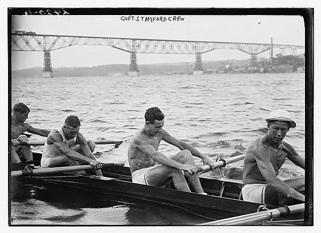 [Stanford University crew rowing on Hudson River with Poughkeepsie Bridge, New York, in background]
