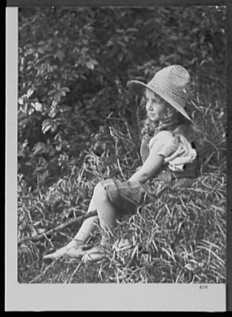 Seventy-one years, or, My life with photography. Doris seated with fishing pole