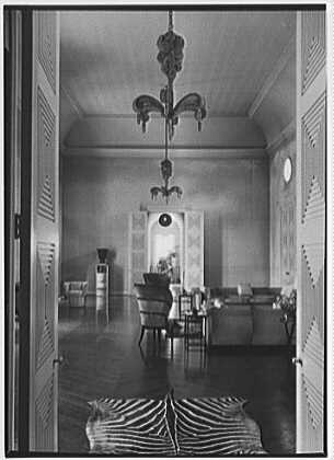 Mrs. William E. Clow, Jr., residence in Lake Forest, Illinois. Living room through doors, vertical