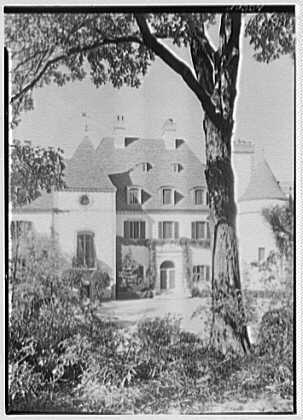 Mrs. Pierre Lorillard, residence in Tuxedo Park, New York. Entrance facade through trees, vertical