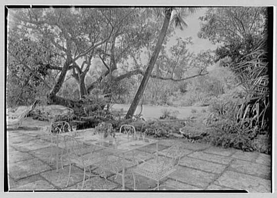 Robert D. Huntington, residence on Travellers Way, Palm Beach, Florida. Patio breakfast table, to lawn