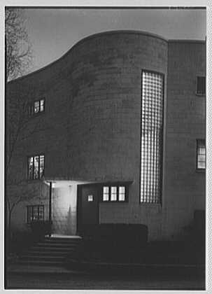 Thomas S. Holden, residence on Tory Hill Rd., Darien, Connecticut. Entrance, vertical, at night