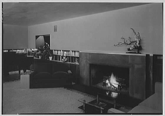 Thomas S. Holden, residence on Tory Hill Rd., Darien, Connecticut. Living room, to fireplace, at night, with fire, sharp