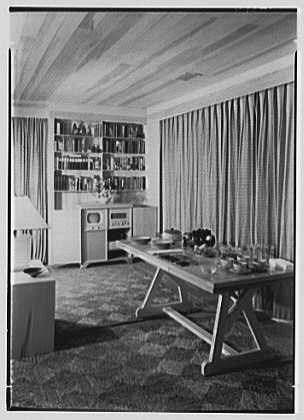 Norman Kent, residence in Weston, Connecticut. Dining room table, television open