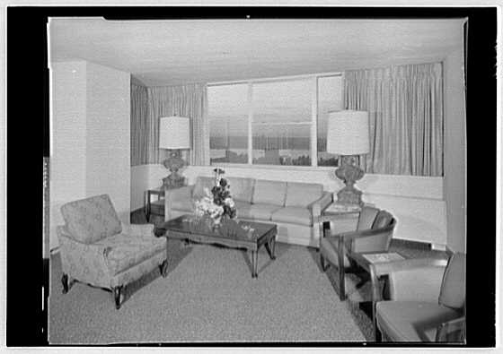 Americana Hotel. Suite 5002, living room, sofa group, day view  through window