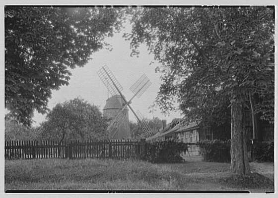 Home Sweet Home, residence in East Hampton, Long Island, New York. Rear of Home Sweet Home and windmill through arch of trees