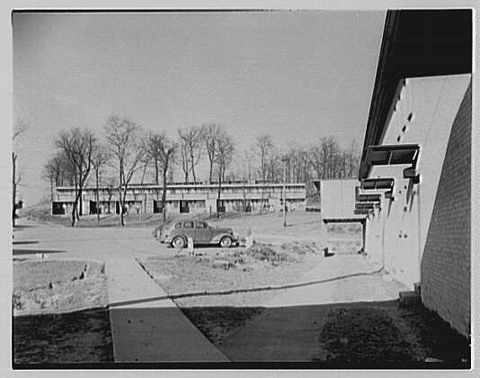 Aluminum City Terrace, New Kensington, Pennsylvania. View of building with car in foreground