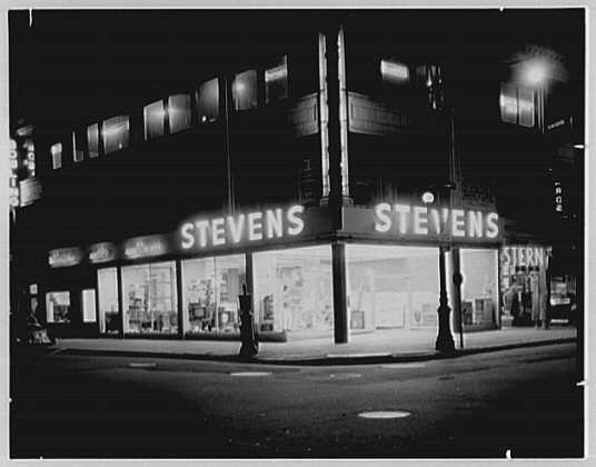 Stevens, business on Astoria Blvd., Astoria, Long Island. Night view
