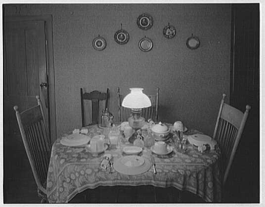 President Calvin Coolidge. Breakfast table, set with iron stone plates, pressed glass and silver teapot