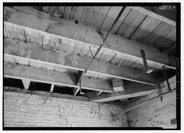 69.  C. 1854 BUILDING, THIRD FLOOR, CEILING DETAIL SHOWING CORNER BEAM SUPPORT FOR HIP RAFTER ABOVE. ALSO SHOWS EAVES SUPPORT DETAIL. - Continental Gin Company, Prattville, Autauga County, AL
