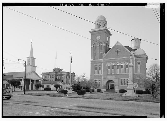 1.  OBLIQUE/EXTERIOR VIEW OF COURTHOUSE SQUARE WITH COURTHOUSE AND CONFEDERATE MONUMENT (RIGHT), JAIL (CENTER LEFT) AND FIRST PRESBYTERIAN CHURCH (LEFT) - Bibb County Courthouse & Jail, Courthouse Square, Centreville, Bibb County, AL