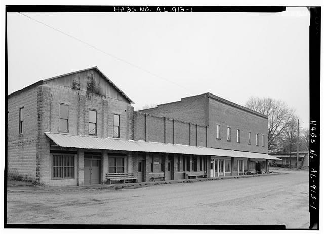 1.  EXTERIOR VIEW, FRONT FACADE (AT FAR RIGHT) OF THE COMMERCIAL BLOCK STREETSCAPE - Harbin Hotel, Carbon Hill Road &Walker County Road 11, Nauvoo, Walker County, AL