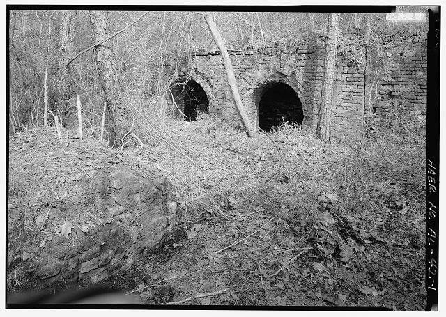 EXTERIOR VIEW, LOOKING SOUTH, WITH BASE OF FURNACE NO. 1 RUINS (LEFT BOTTOM) AND HOT BLAST STOVE RUINS (RIGHT TOP). - Shelby Iron Works, County Road 42, Shelby, Shelby County, AL
