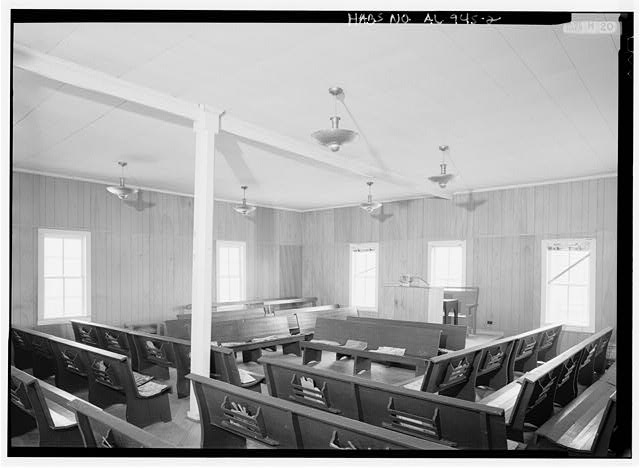 2.  INTERIOR VIEW, OBLIQUE PERSPECTIVE LOOKING ACROSS PEWS (WITH RACKS FOR FANS AND HYMNALS) TO PULPIT. - Sardis Baptist Church, Sanders' Ferry, Wilson's Crossing, Warrior River, Cordova, Walker County, AL