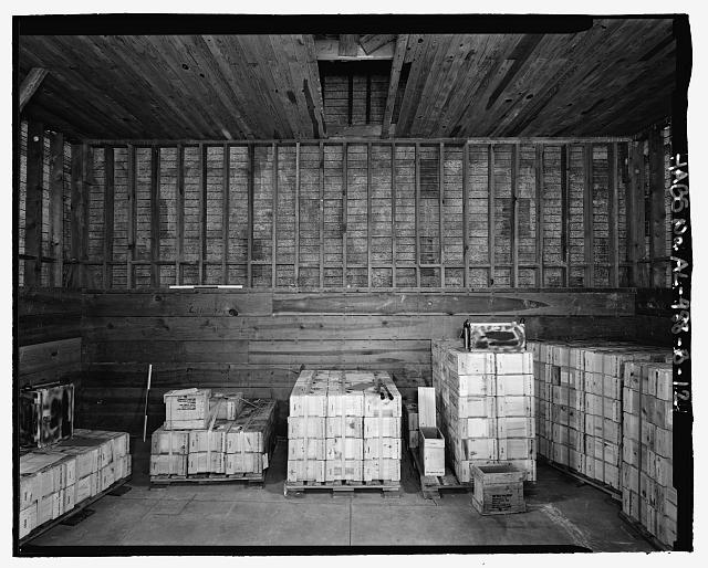 Interior planar view of south wall, view towards the south southeast with scale - Fort McClellan Ammunition Storage Area, Building No. 4404, Second Avenue (Magazine Road), Anniston, Calhoun County, AL