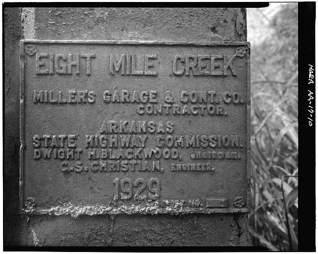 10.  DETAIL VIEW, LOOKING NORTH, SHOWING COMMEMORATIVE PLAQUE ON EAST SIDE OF SOUTH APPROACH WHICH STATES 'EIGHT MILE CREEK; MILLERS GARAGE & CONT. CO.; CONTRACTOR.; ARKANSAS; STATE HIGHWAY COMMISSION.; DWIGHT H. BLACKWOOD, CHAIRMAN.; C.S. CHRISTIAN, ENGINEER.; 1929.; BRIDGE NO.__' - Eight Mile Creek Bridge, Spanning Eight Mile Creek at U.S. Highway 49, Paragould, Greene County, AR