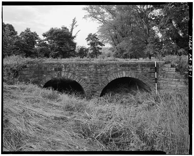 1.  VIEW, SOUTH ELEVATION, LOOKING NORTH (SCALE ROD IS MEASURED IN FEET) - Milltown Bridge, Spanning Vache Grasse Creek tributary at County Road No.77, Milltown, Sebastian County, AR