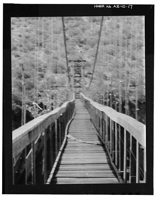 17.  Historic photograph, photographer unknown, 1943. ENLARGEMENT OF PORTION OF PHOTOGRAPH AZ-10-16, SHOWING WOOD TOWER BEFORE CONCRETE WAS ADDED. NOTE GUY CABLE CONNECTED TO TOP RIGHT OF TOWER. - Verde River Sheep Bridge, Spanning Verde River (Tonto National Forest), Cave Creek, Maricopa County, AZ