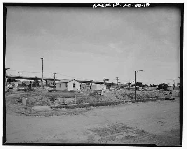 VIEW LOOKING SOUTHEAST TOWARD WEST SIDE OF SETTLING RESERVOIR NO. 1. THE BLAISDELL SLOW SAND FILTER WASHING MACHINE IS SEEN AT THE LEFT. MAIN STREET IS IN THE FOREGROUND. - Yuma Main Street Water Treatment Plant, Jones Street at foot of Main Street, Yuma, Yuma County, AZ