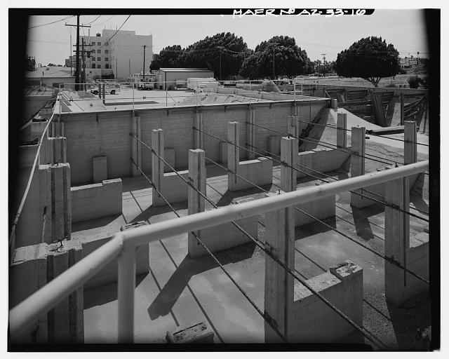 VIEW LOOKING SOUTHWEST INTO THE NORTH PORTION OF SETTLING RESERVOIR NO. 2. SETTLING RESERVOIR NO. 1 IS SEEN AT THE UPPER RIGHT. THE CONCRETE COLUMNS WERE ADDED IN 1944 TO SUPPORT FLOCCULATING EQUIPMENT. - Yuma Main Street Water Treatment Plant, Jones Street at foot of Main Street, Yuma, Yuma County, AZ