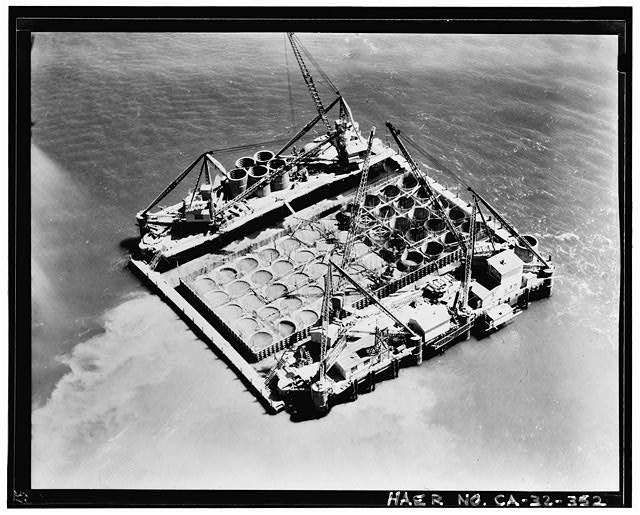 352.  Clyde Sunderland, Photographer May 11, 1934 AERIAL VIEW OF FLOATING CAISSON UNDER CONSTRUCTION. - San Francisco Oakland Bay Bridge, Spanning San Francisco Bay, San Francisco, San Francisco County, CA
