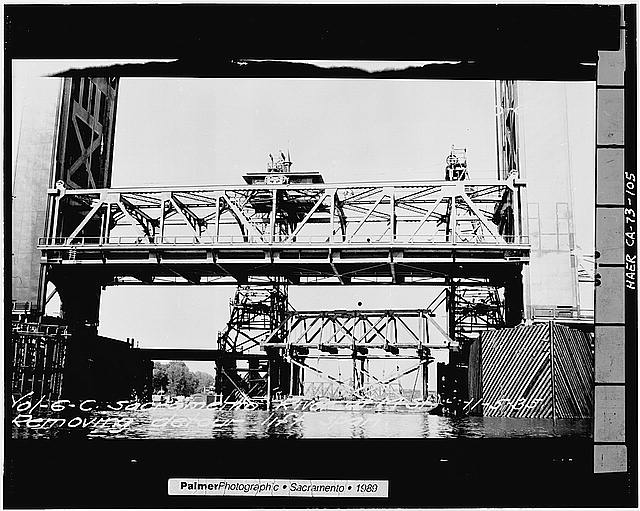 105.  VIEW SHOWING THE REMOVAL OF SHOOFLY BRIDGE LIFT SPAN, LOOKING NORTH-NORTHEAST, November 5, 1935 - Sacramento River Bridge, Spanning Sacramento River at California State Highway 275, Sacramento, Sacramento County, CA
