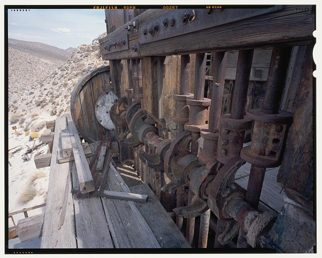 48.  DETAIL OF STAMP BATTERIES CAMS, TAPPETS AND STEMS WITH SIX FOOT SCALE, LOOKING NORTH NORTHWEST. SEE CA-290-24 FOR IDENTICAL B&W NEGATIVE. - Skidoo Mine, Park Route 38 (Skidoo Road), Death Valley Junction, Inyo County, CA