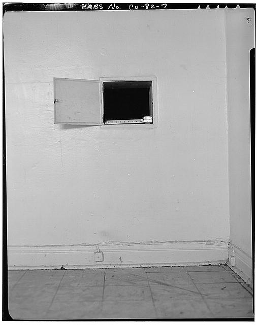 7.  INTERIOR VIEW OF KITCHEN WALL SHOWING PASS THROUGH AND BASEBOARD - Golda Meir House, 1606-1608 Julian Street (moved to 1301 South Lipan Street), Denver, Denver County, CO